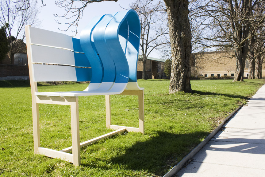 Companion bench, 2015   Maple, ply, rubber  A bench for solace during the grievance of a loved one. When the griever interacts with the bench the blue form reacts to the user's weight creating a physical presence.                                                                                                                                                                Private Collection