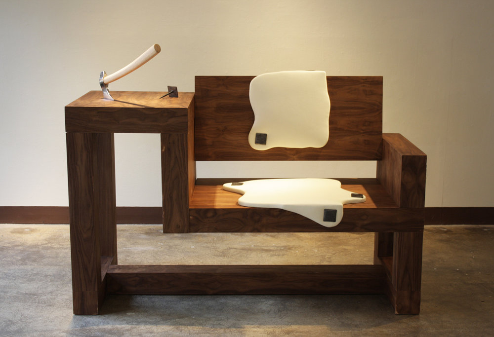 medieval modern, 2014   Walnut veneer, ply, pleather, forged nails, axe  a documentation of man. our behaviors, lifestyles, the value of objects and prescribed roles in our social paradigm. Through the exploitation of materials, objects and ideals, the bench seat absorbs the room with references of barbaric tendencies and the modern brute.                                                                                                                                                                   private collection