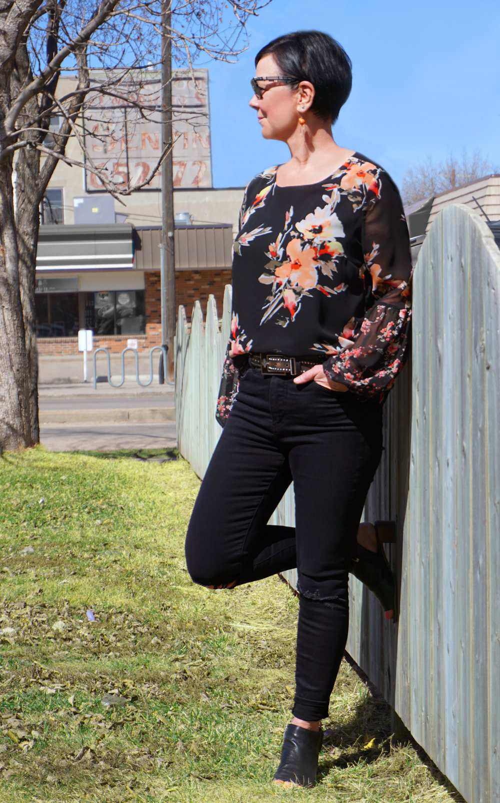 Here Colleen is wearing a floral chiffon blouse with coral earrings to match. Notice the blouse has a black background, keeping within the black palette she loves.