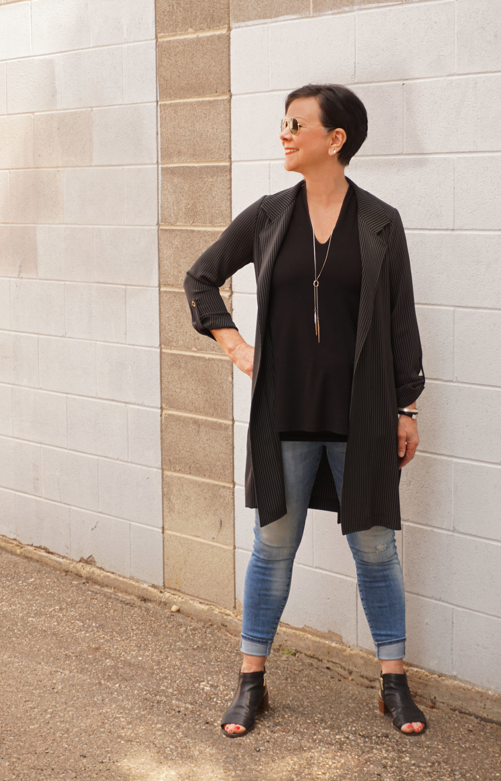 Here Colleen is wearing another lightweight jacket, this time with a looser blouse-like feel. Tiny pinstripes add some interest, but let's face it, this is mostly black and that's okay.