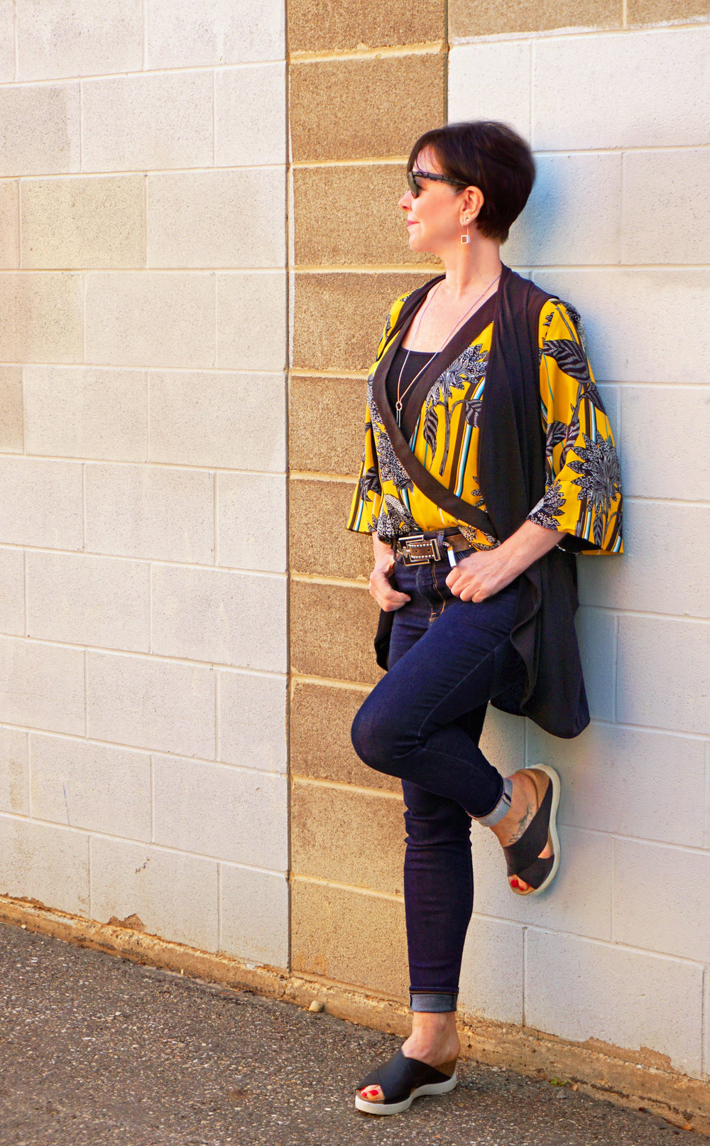 With this look, Colleen has added the Class Act vest from Sympli to tone down the vibrant yellow blouse.