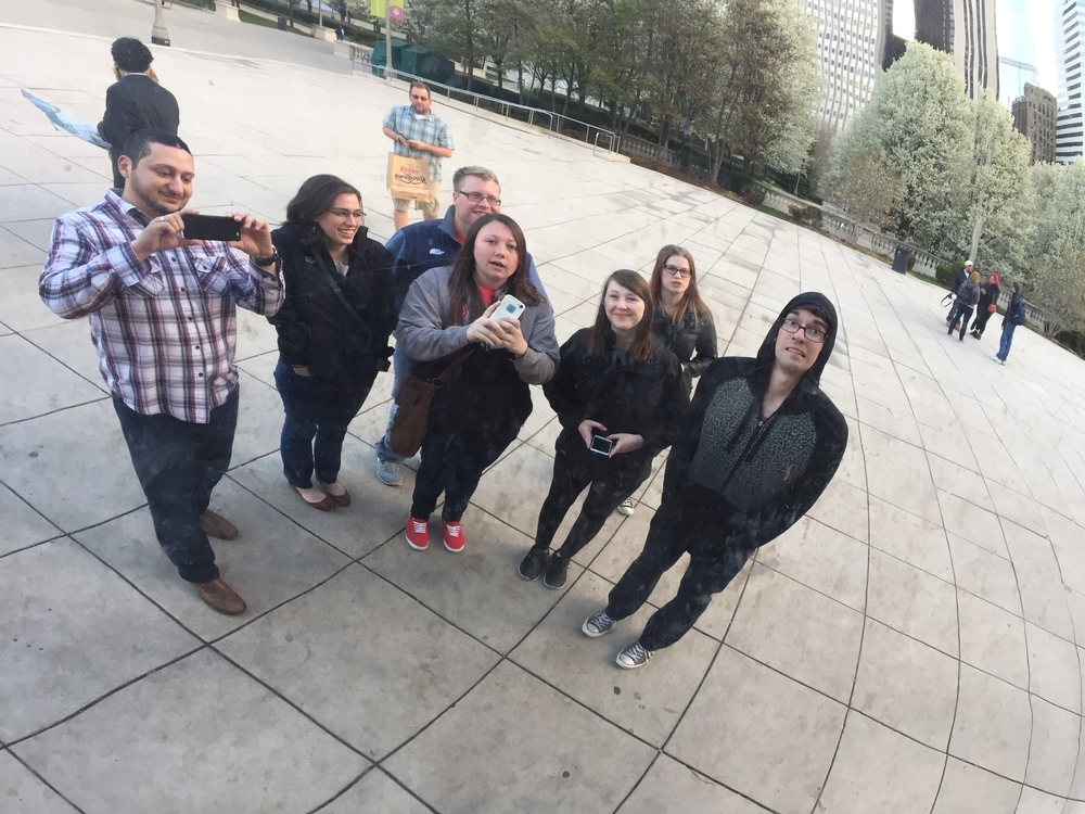 Dr. Okdie and some ANT lab students taking a selfie in the Bean at Millennium Park in Chicago.