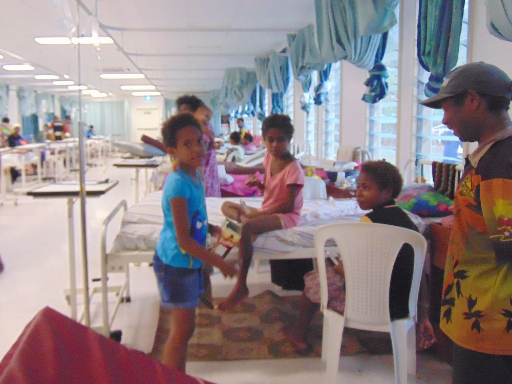 Pictured is one of the Labi children handing out items to the patients.