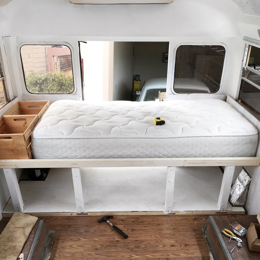 Bed frame with lots of storage space underneath.