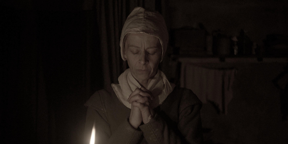 The Witch a horror film directed by Robert Eggers starring Kate Dickie, Anna Taylor-Joy, Ralph Ineson, Harvey Scrimshaw, Black Phillip from Sundance Film Festival