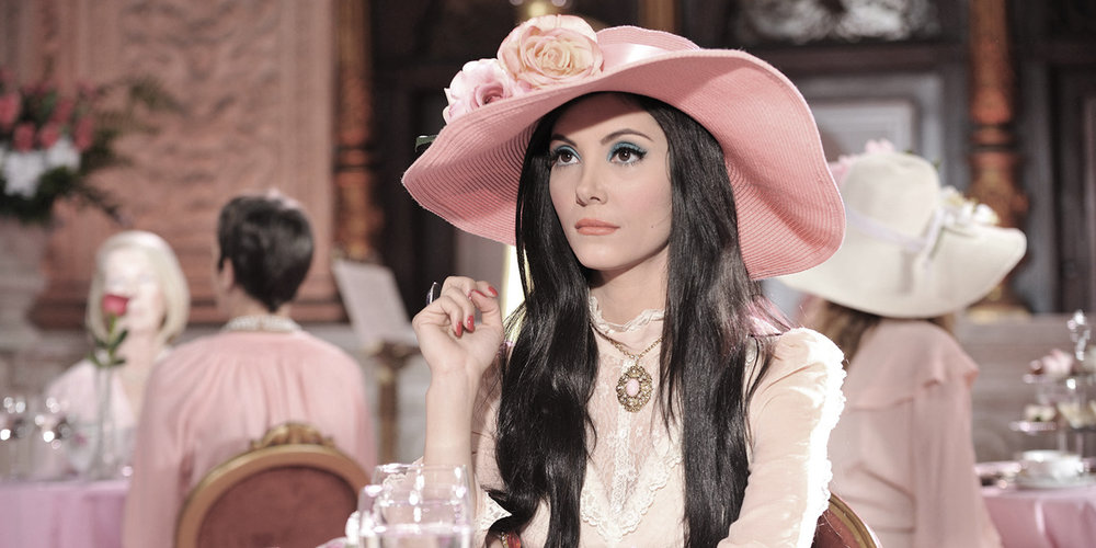 Samantha Robinson in the pink tea room as Elaine in The Love Witch directed by Anna Biller