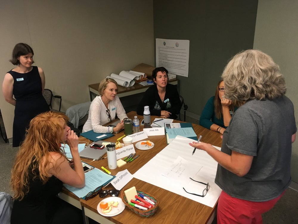 Truckee Elementary teachers and Vice Principal construct a road map for their global education program while Asia Society's Center for Global Education Associate Director Heather Singmaster observes.