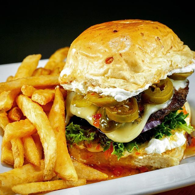 The Jalapeño Burger:  if you haven't tried it yet you're missing out on one of our favorite signature menu items.  A mouth watering combo of sweet and spicy complimented by our homemade jalapeño apricot jelly and a whipped cream cheese spread this gourmet burger just might change your life 😍