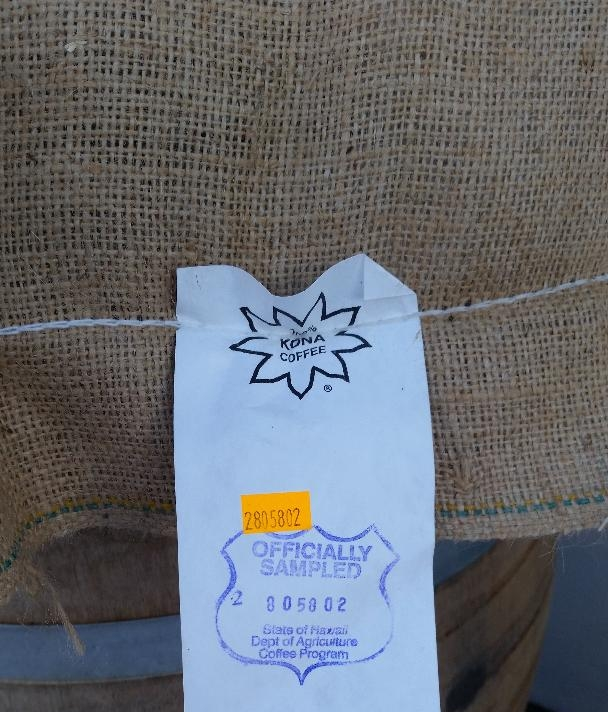 Green coffe sacs with USDA 100% Kona seal