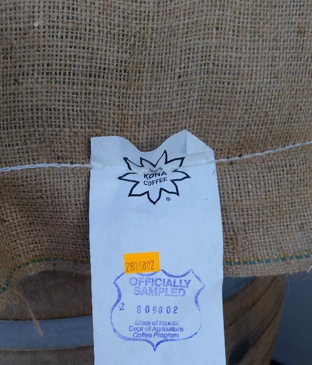 Green coffe sacs with USDA 100% Kona seal