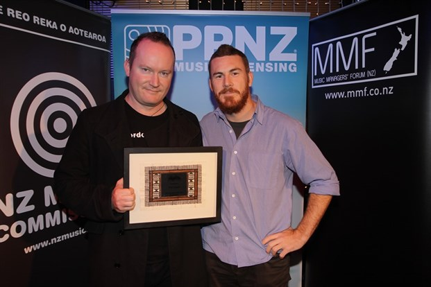 Paul McLaney MushroomPublishing accepting South Island Manager Award for Tim Couch (Knives at Noon) with presenter Richard Setford (Batucada Sound Machine)