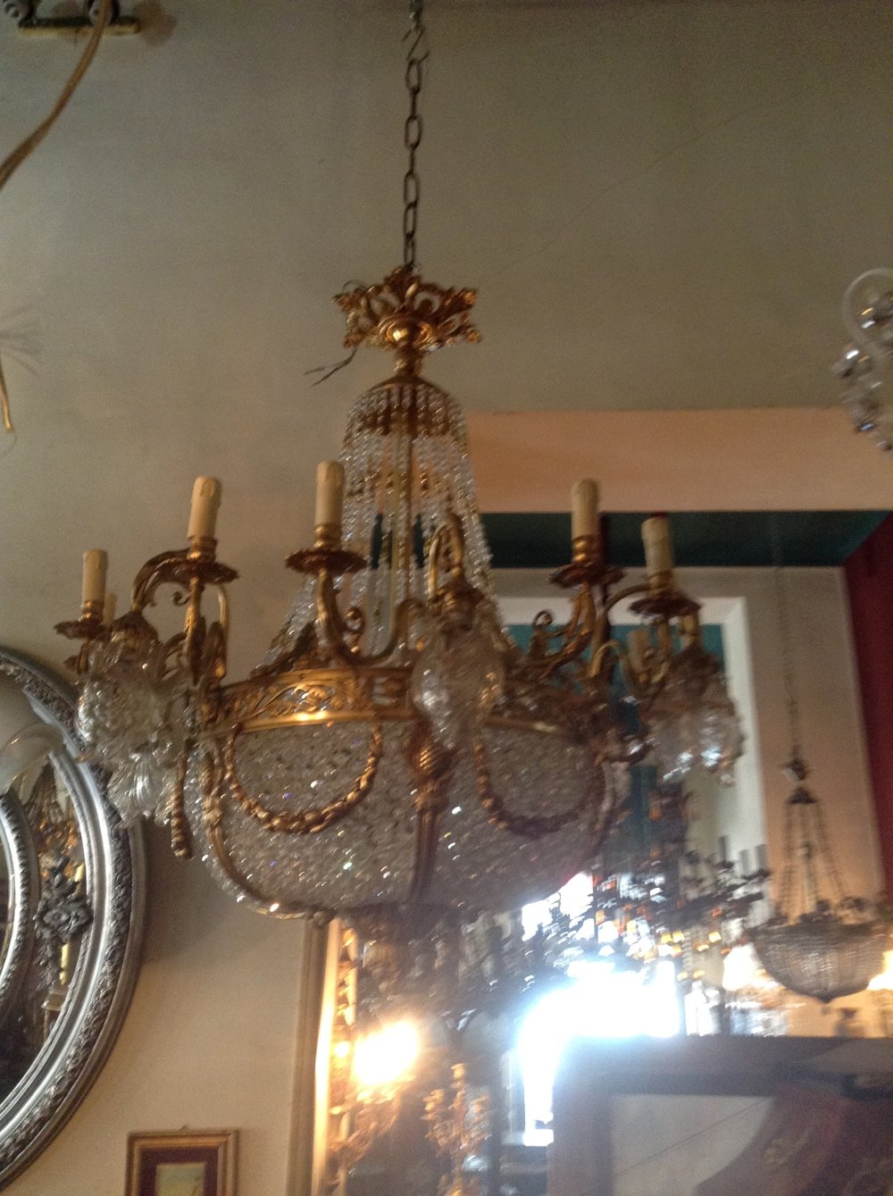 Large ornate chandelier with detailed brass ornamentation renaissance large ornate chandelier with detailed brass ornamentation aloadofball Gallery