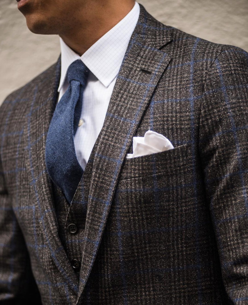 With a bold jacket like this, your best bet is to choose a plain cotton/linen or fine-patterned pocket square that tones nicely with your ensemble.  image: courtesy Instagram @articlesofstyle