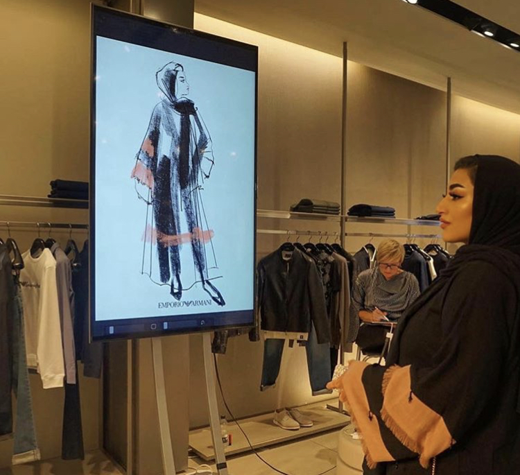Jacqueline sketching a guest at The Mailbox, Birmingham. An  evening event for  Emporio Armani.   Guests were presented with their printed fashion portraits in frames.