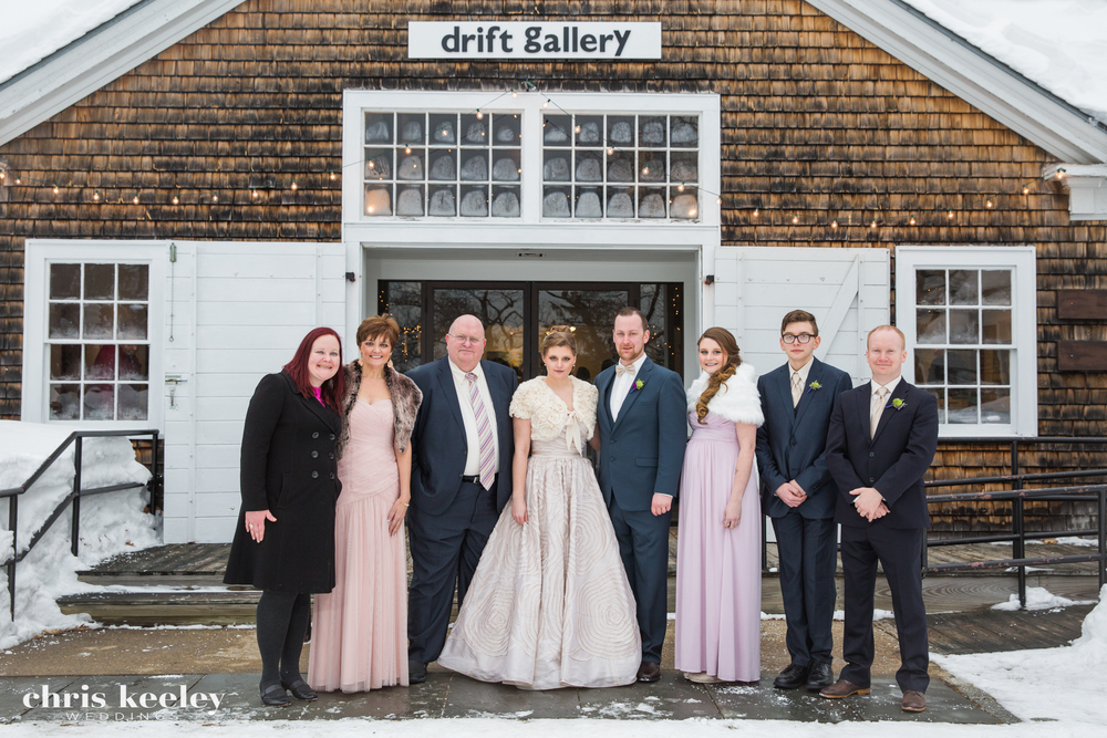 It's smart to photograph the family photos with a backdrop that identifies where your wedding took place. An overcast day, shown here at this winter wedding at the Drift Gallery in Portsmouth, New Hampshire, will allow for the family photos almost anywhere.