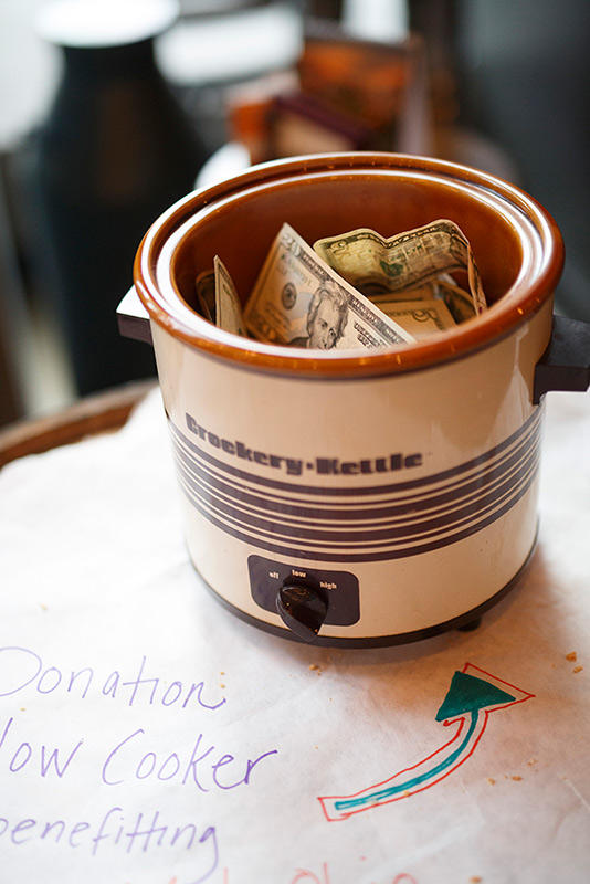 Hungry to help - A guest stands up to locate the bread basket. Asks the table who wants some and heads on over.That's when they meet the Donation Slow Cooker. They realize that they are warm, they are fed, they are surrounded by a wonderful community. And with gratefulness they pay it forward by throwing what they can, or want to, into this vessel.There are no rules about giving here. It is between the guest and the slow cooker. It's not unlikely to find a $100 bill and a bag full of change in the same pot. And it's beautiful.