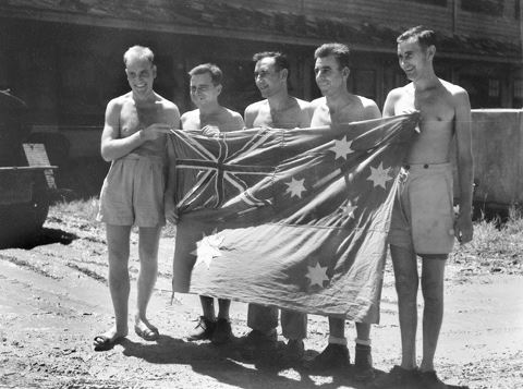 ANF - Prisoners of War near Saigon 1940s with hand made Australian National Flag.jpg