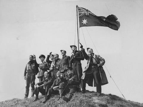 ANF - RAAF men on hillock raise the ANF in England.jpg