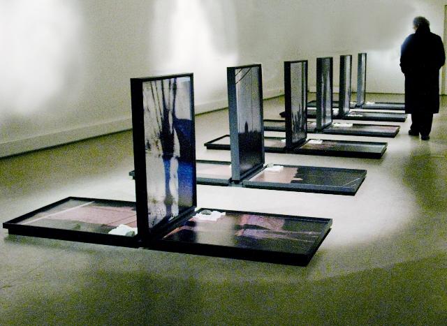 """Wordless"" installation                                                        photos on metal 9  0X7  0m"