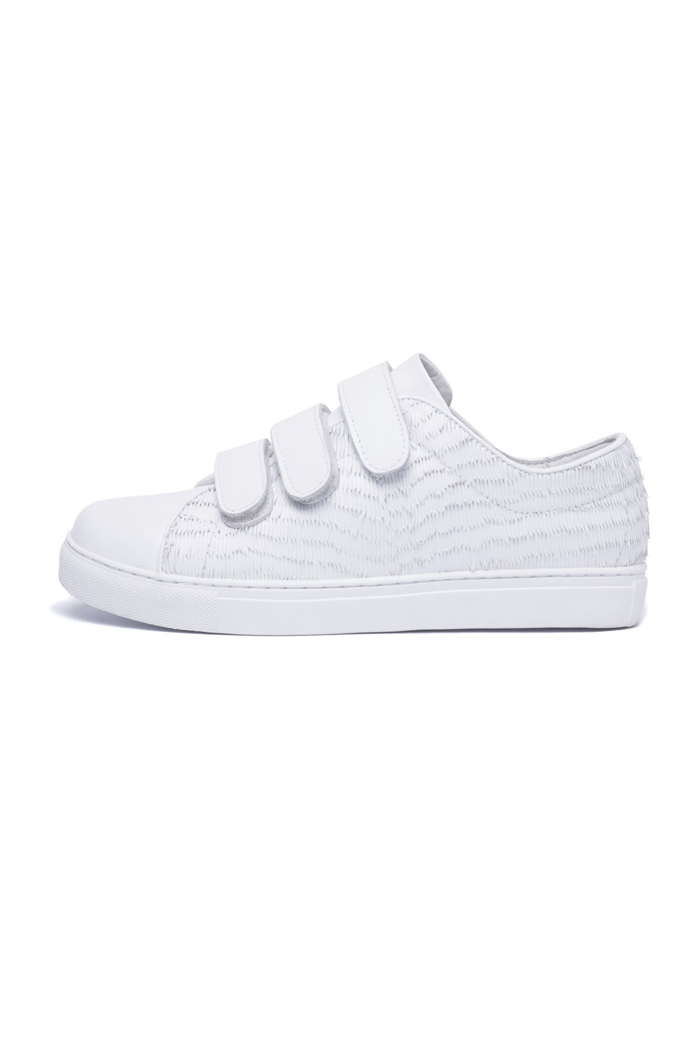 HELI Velcro Sneakers $305 - White sneakers are a favorite for a reason and prove the athleisure trend has no plans of slowing down. Grab the Heli leather sneakers to bring comfort to tailored 9-to-5 looks and off-duty days. These are the Velcro sneakers you shouldn't be ashamed to wear!