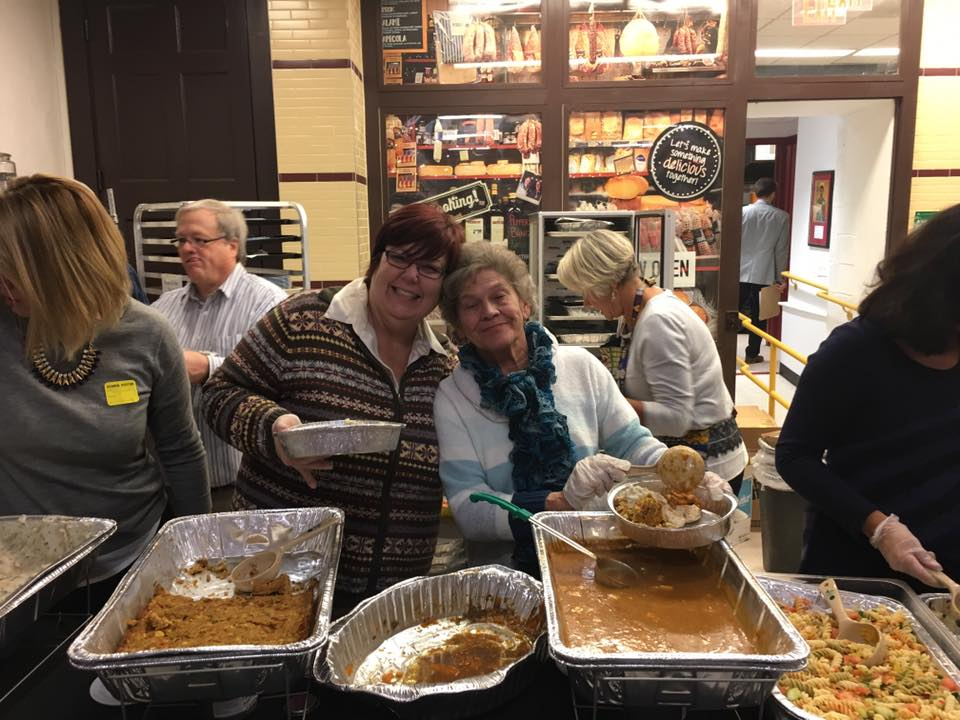 Nancy and Sue helping serve at the annual Thanksgiving Dinner for all the students and families of St. James School