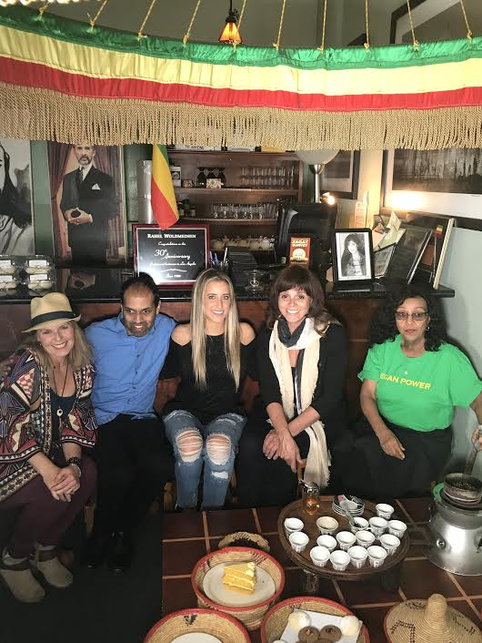 Paige, Prabhat, Me, Jane, and Rahel at Rahel's Vegan Cuisine! Rachel is roasting the beans for the ceremony.