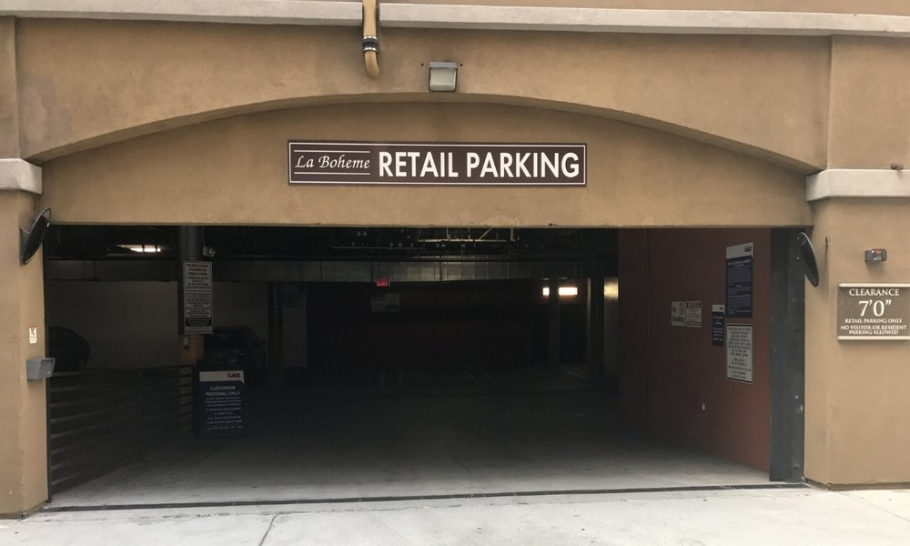 "After parking, follow the white ""La Boheme Retail Access"" signs outside to the 30th st. sidewalk. Turn right (north) and go about 100ft to our front door. We are just past the dentist, inside The Suite Spot."