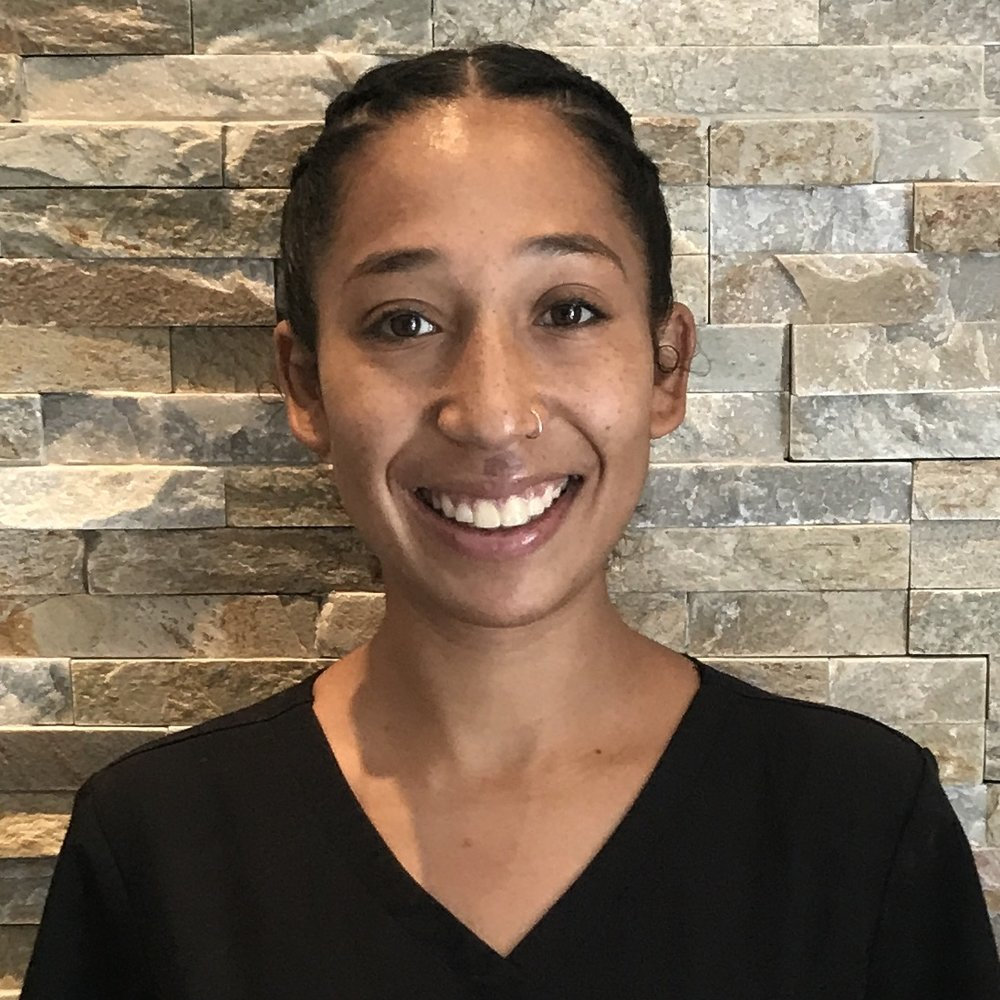 Jasmine - Certified TherapistShe approaches massage through Deep Tissue, Therapeutic Clinical Techniques & Sensory Repatterining. Jasmine believes massage is essential to nourish our bodies. She is knowledgeable, intuitive, powerful, and is even a certified EMT!