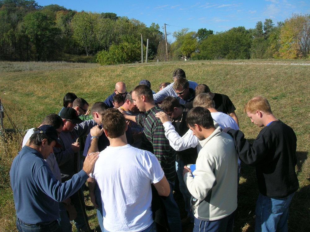 prayer-around-Reid.jpg