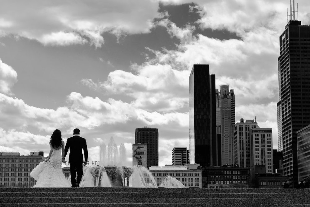 We scout locations for nearly every wedding, even though we have been shooting in Chicago, collectively, for almost 30 years. Every year the city changes, and each scout trip yields a new perspective on an old spot. Jeremy killed it with this portrait at Buckingham fountain!