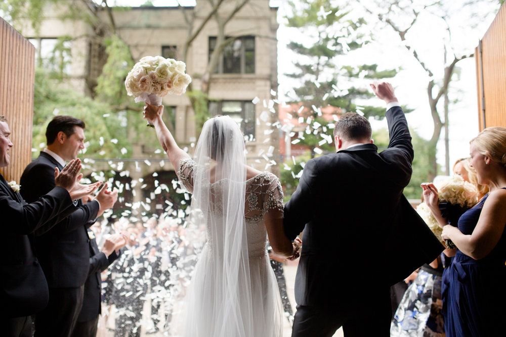 Bride and groom exit St Michael's wedding ceremony as guests throw confetti