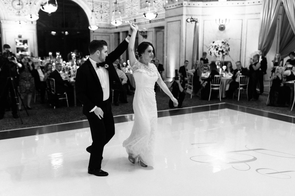 Bride and groom enter wedding reception at Chicago Cultural Center