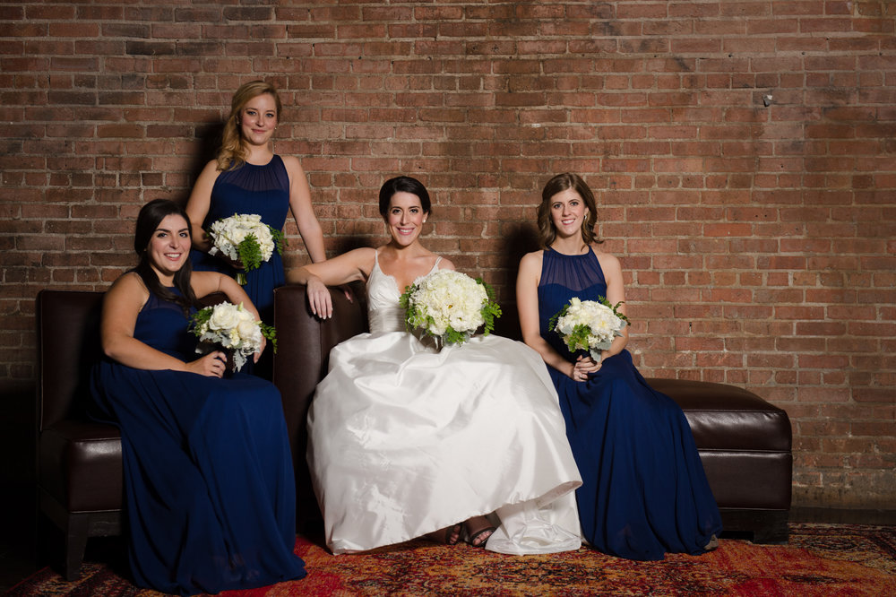 Bridesmaids in blue gowns at Morgan Manufacturing wedding