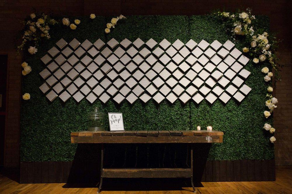 Modern floral escort card wall at Bridgeport Art Center Skyline Loft Wedding
