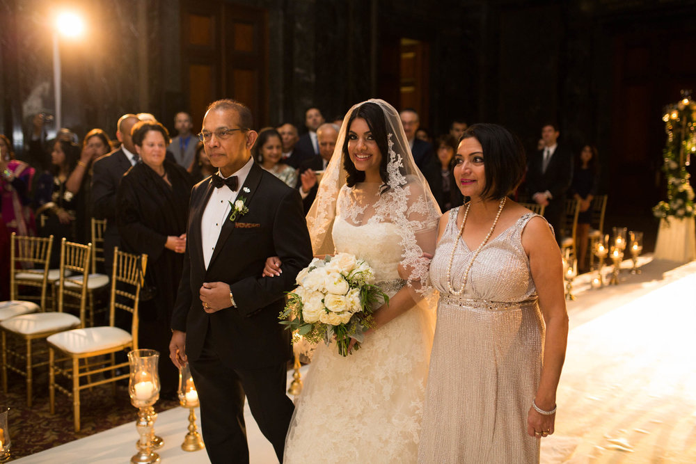 Bride and parents enter wedding ceremony at Chicago Cultural Center