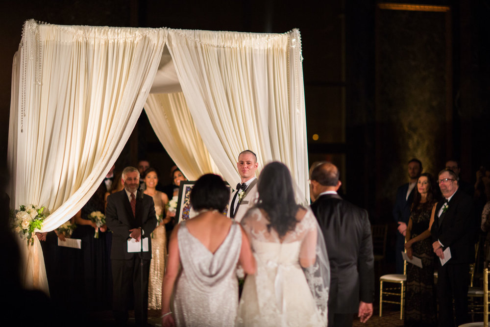 Groom sees bride for the first time at Chicago Cultural Center wedding ceremony