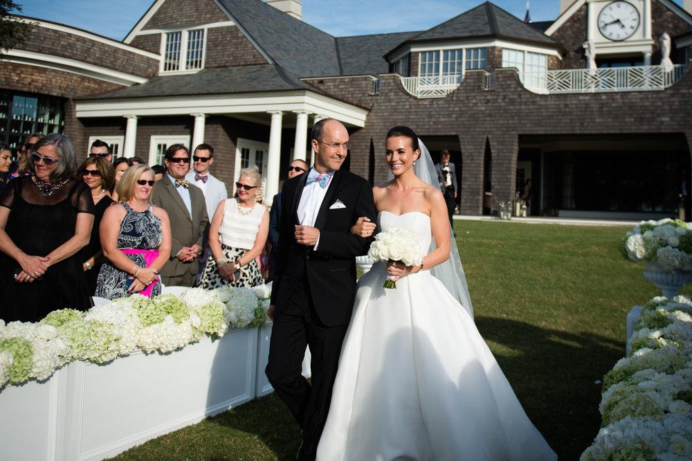 Bride's father walks her down the aisle at Kiawah Island Golf Club wedding ceremony