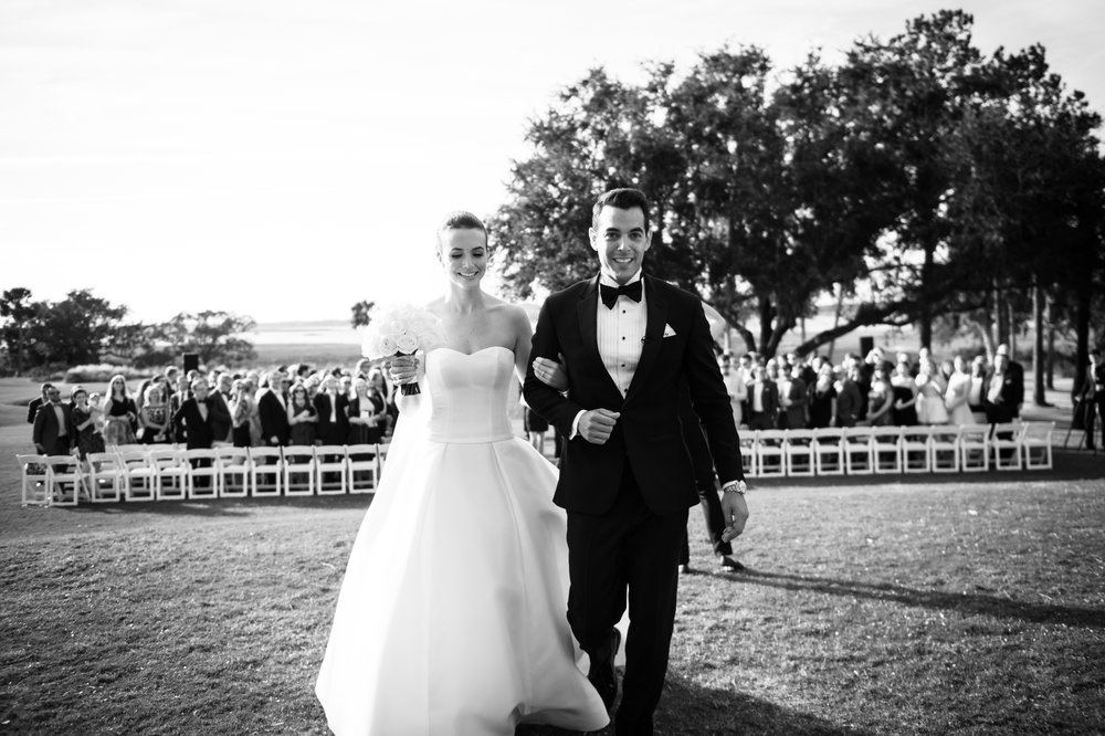 Bride and groom exit wedding ceremony at Kiawah Island Golf Club River Course