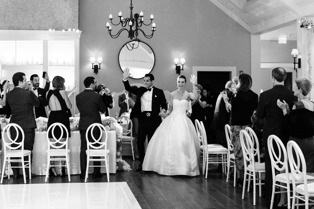 Bride and groom enter wedding reception at Kiawah Island River Course
