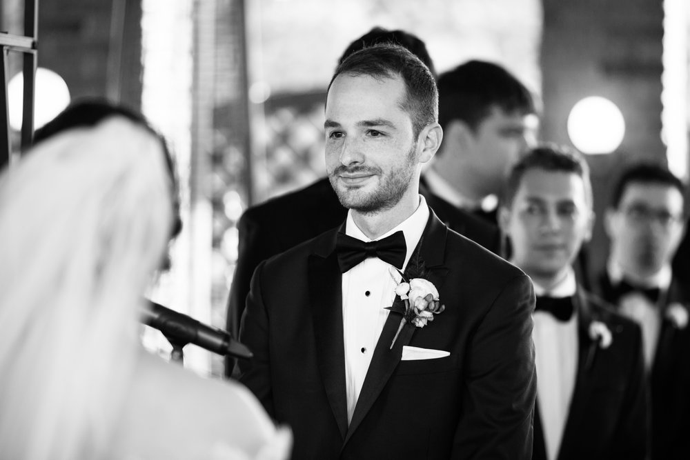 Groom at wedding ceremony Chicago Cafe Brauer