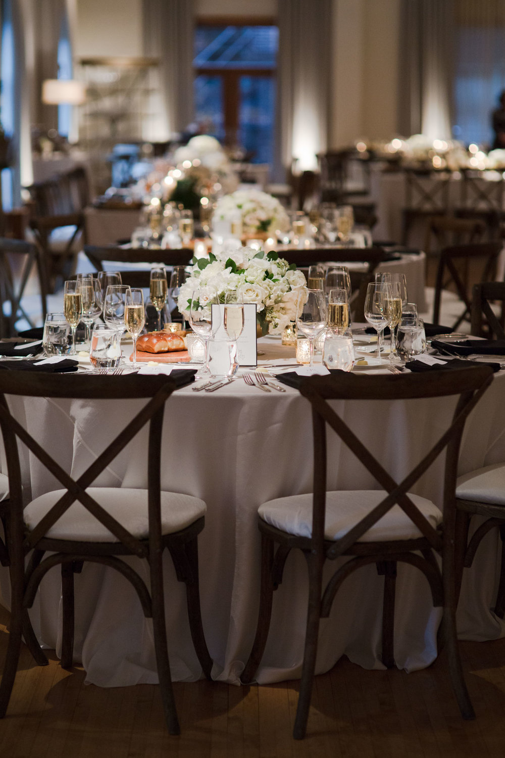 A Stem Above Chicago created these gold and white tablescapes for a May wedding at the Ivy Room.