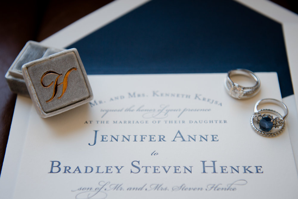 We photographed the wedding invitation along with the bride's rings and monogrammed ring box at the Sheraton Grand in Chicago prior to the 4th Presbyterian ceremony and Harold Washington Library reception.
