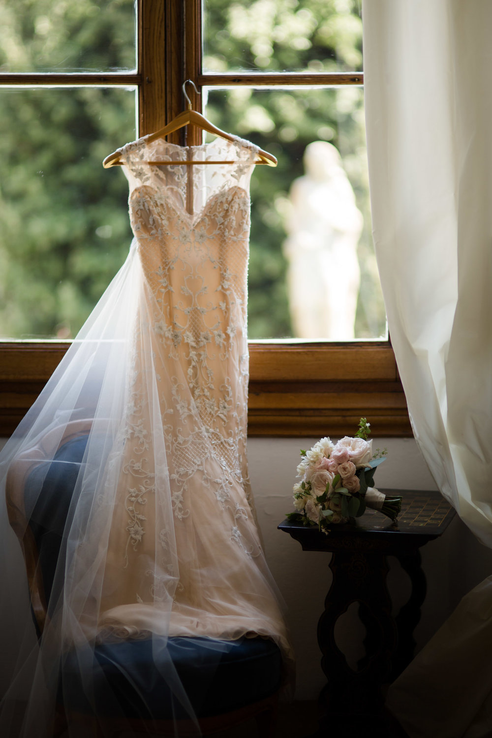 The blush bridal gown was a custom Monique Lhuillier for this Florence, Italy wedding.