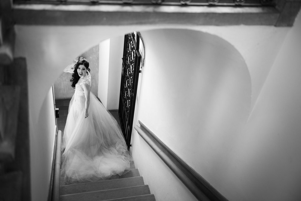 We love this shot of the bride looking back over her shoulder as she descends the stairs down to the gardens from the bridal suite.