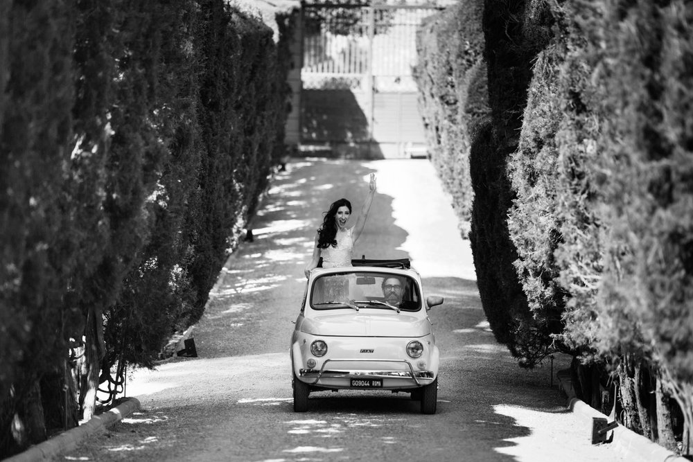 This is a fun classic black and white photograph driving a cinquecento through gardens at a villa in Italy.