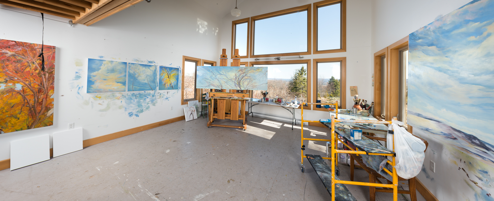 Inside the studio, Spring 2016. Photo, Joy Cummings Portale on the left wall is followed by works that would become Spring Suite. Late Winter 2016, a diptych in process, sits on the right wall. Hanging in front of Portale is the strap for pull down staircase to the loft area where I store, stretch and prime canvas.