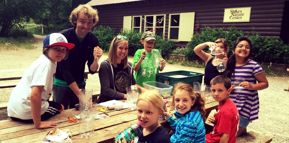 Camp Staff leading STEM activities with summer campers at Stokes Nature Center.