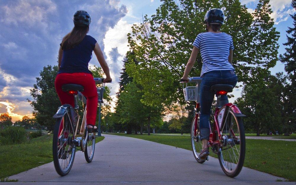Two girls on bikes City Park.jpg