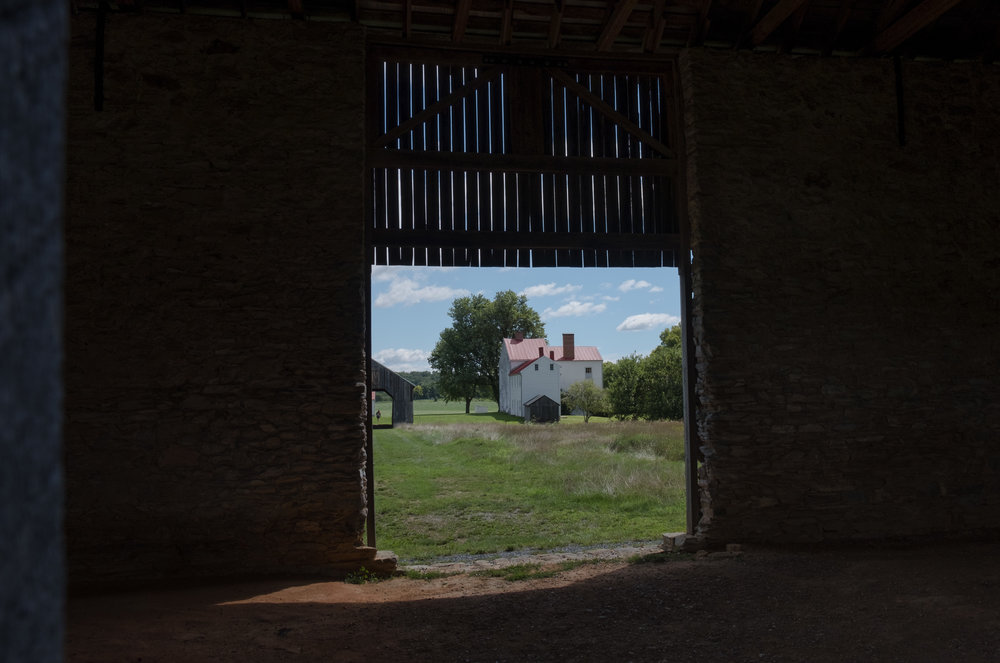 View of the house from inside the barn.