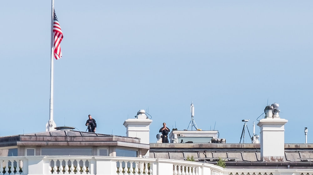 There were at least four people on the roof with rifles and scopes
